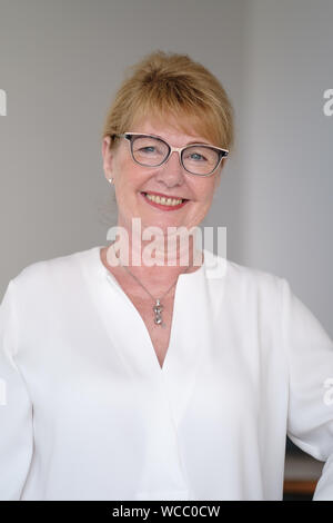 Hanover, Germany. 22nd Aug, 2019. Cathrin Burs, the new President of the Chamber of Pharmacists of Lower Saxony, smiles. In Lower Saxony, the number of pharmacies has fallen by more than 10 percent since 2009 to currently 1892. When rural doctors' practices close, local pharmacists often do not find a successor either. The new president of the Chamber of Pharmacists of Lower Saxony, Cathrin Burs, hopes for impulses from the Pharmacy Strengthening Act planned at federal level. Credit: Ole Spata/dpa/Alamy Live News - Stock Photo