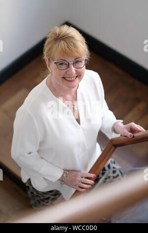 Hanover, Germany. 22nd Aug, 2019. Cathrin Burs, new president of the Chamber of Pharmacists of Lower Saxony, smiles. In Lower Saxony, the number of pharmacies has fallen by more than 10 percent since 2009 to currently 1892. When rural doctors' practices close, local pharmacists often do not find a successor either. The new president of the Chamber of Pharmacists of Lower Saxony, Cathrin Burs, hopes for impulses from the Pharmacy Strengthening Act planned at federal level. Credit: Ole Spata/dpa/Alamy Live News - Stock Photo