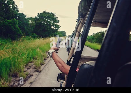 Cropped Hand Of Man Taking Selfie While Traveling In Vehicle - Stock Photo