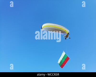 Low Angle View Of Paraglider In Mid Air With Bulgarian Flag - Stock Photo