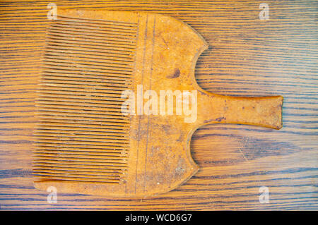 Old wooden comb for manual spinning machine. Hand tool. - Stock Photo