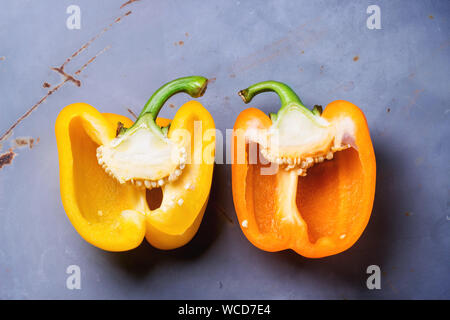 High Angle View Of Halved Yellow Bell Peppers On Metallic Table