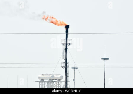 Low Angle View Of Smoke Emitting From Chimney At Factory Against Clear Sky - Stock Photo