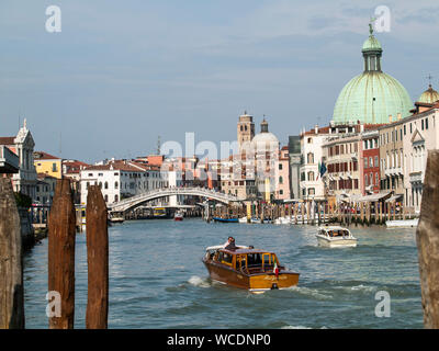 Water Taxi In Grand Canal By San Simeone Piccolo Against Sky - Stock Photo