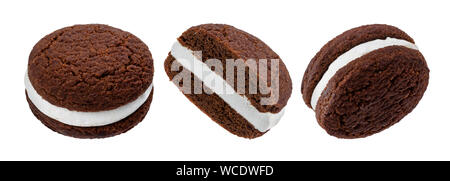Chocolate sandwich cookies, baked biscuits stuffed with milk cream isolated on white background - Stock Photo