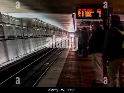Commuters Waiting At Subway Station Platform - Stock Photo