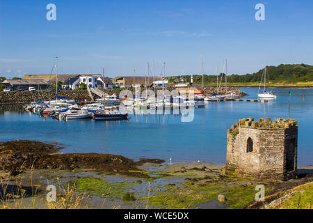 8 august 2019 A small medieval stone tower overlooking the marina and harbour at Ardglass County Down northern Ireland on a hot day in summer - Stock Photo