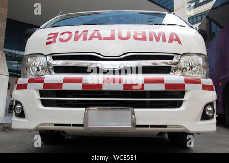 Ambulance car, front view. Emergency rescue service van parked at hospital. - Stock Photo