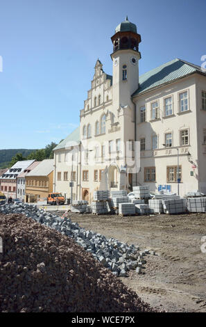 Jachymov, Germany. 08th Aug, 2019. The street in front of the town hall of the Czech spa and mining town is being renovated. The Montan region Erzgebirge has been recognised as part of the world cultural heritage since July 2019. (to dpa KORR) Credit: Michael Heitmann/dpa/Alamy Live News - Stock Photo