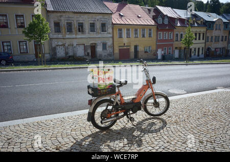Jachymov, Germany. 08th Aug, 2019. A moped with a Persil carton as a container stands on the luggage carrier in the Czech mining town, which has already seen better times. The Montan region Erzgebirge has been recognised as part of the Unesco World Cultural Heritage since July 2019. In the city they hope to get more visitors and attention. (to dpa KORR) Credit: Michael Heitmann/dpa/Alamy Live News - Stock Photo