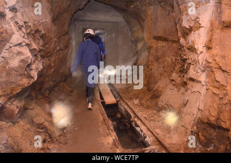Jachymov, Germany. 08th Aug, 2019. Underground in the mine, unity in the Czech spa and mining town, which looks back on a long history. Flashlights are the only light source. First silver was mined here, then uranium. Today radon-containing water is extracted for the spa operation. The Montan region Erzgebirge has been recognised as part of the world cultural heritage since July 2019. Credit: Michael Heitmann/dpa/Alamy Live News - Stock Photo