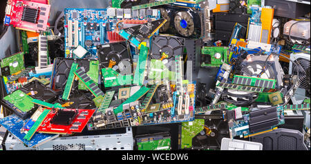 E-waste recycling. Used computer parts. Electronic, plastic and metal refuse. Big colorful pile of discarded or obsolete laptop and PC components. - Stock Photo