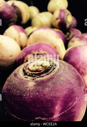 Turnips For Sale At Market Stall - Stock Photo