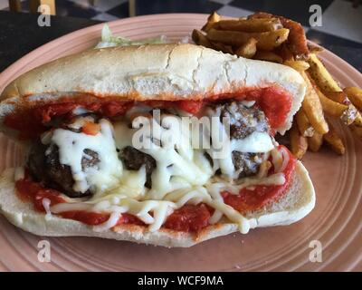 Meatball Sandwich With French Fries In Plate On Table - Stock Photo