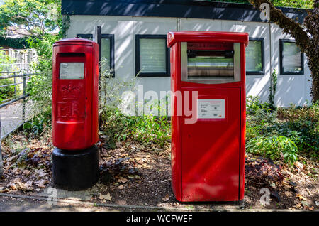 Royal Mail mail boxes in Tywford, Berkshire, UK. One is for letters and the other is for pre-paid parcels and packages. - Stock Photo
