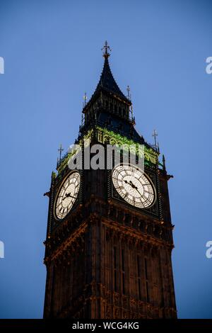 A vertical shot of the Big Ben clock tower in London, England under a clear sky - Stock Photo