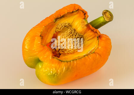 Close-up Of Yellow Bell Pepper Against Beige Background
