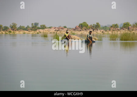 Local fishermen floating on makeshift rafts on the Ken River, Panna National park, Madhya Pradesh, India, Central Asia - Stock Photo
