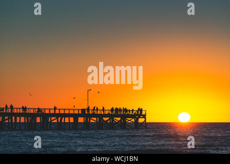 Semaphore Beach  pier with people at sunset, Adelaide, South Australia - Stock Photo