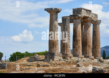The ruins of the 5th century Doric Temple of Apollo in Ancient Corinth in Greece - Stock Photo