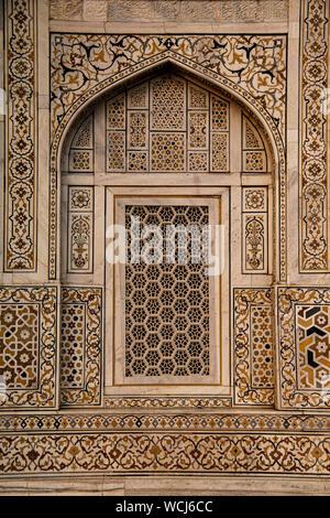 Geometric window design, with beautiful pietra dura stone work. Itimad-ud-Daulah Tomb (Baby Taj), at sun set, Agra, Uttar Pradesh, India, Central Asia - Stock Photo