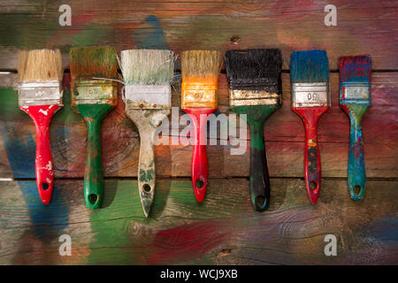 Close-up Of Paintbrushes On Table Stock Photo