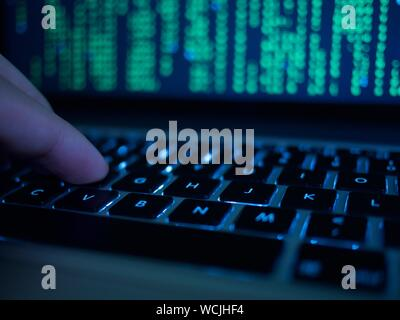 Cropped Hand Of Computer Hacker Typing On Keyboard