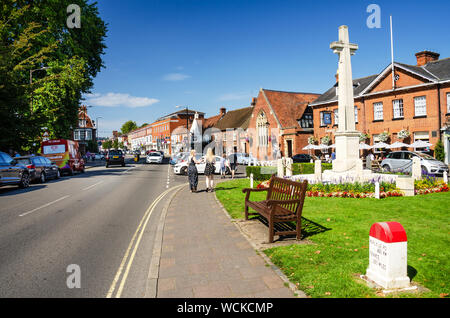 A war memorial in the form of a large stone cross at the bottom end of The High Street in Marlow, Buckinghamshire, UK - Stock Photo