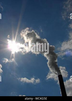 Low Angle View Of Smoke Emitting From Chimney - Stock Photo