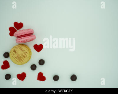 Sweet cake macaron and colorful almond macaron cookies on white background with copy space for text. - Stock Photo