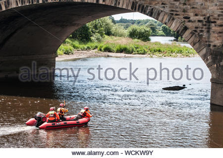 Lancashire Fire & Rescue training in the banks of the River Ribble at Preston - Stock Photo