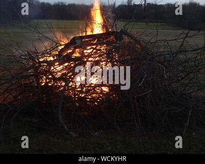 Close-up Of Branches Burning On Field - Stock Photo