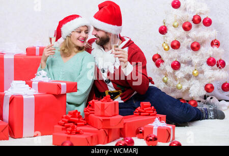 Family tradition. Happy new year and merry christmas. Celebrating christmas together. Loving couple cuddle and drink champagne near christmas tree. Couple in love enjoy christmas holiday celebration. - Stock Photo