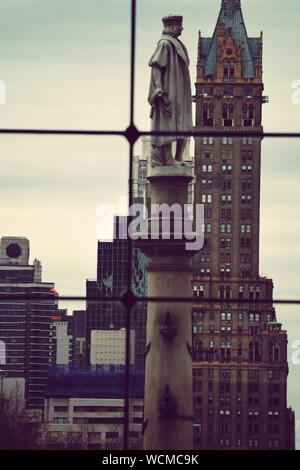 Christopher Columbus Statue In Columbus Circle In City Against Sky - Stock Photo