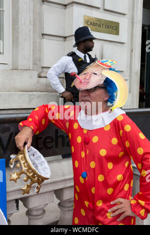 On the day that British Prime Minister Boris Johnson sought to have Parliament suspended by Queen Elizabeth, days after MPs return to work in September - and only a few weeks before the Brexit deadline, pro-EU Remain voters protest outside the Cabinet Office where daily Brexit contingency planning meetings take place, on 28th August 2019, in Whitehall, Westminster, London, England. - Stock Photo