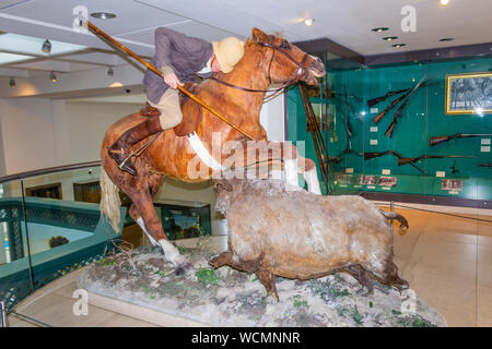 The Royal Armouries Museum, Leeds, West Yorkshire, England.  Exhibit in the Hunting gallery of a hunter spearing a boar. - Stock Photo