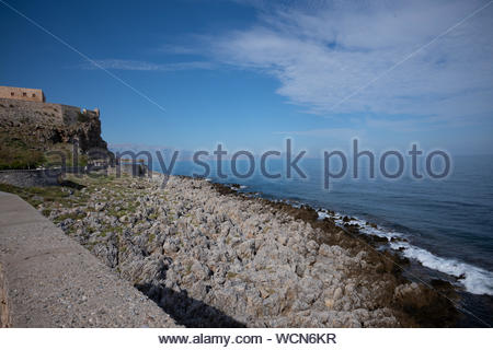 Venetial castle of Fortezza built on a hill called Paleokastro by the sea in the heart of picturesque city of Rethymno, Crete island, Greece - Stock Photo