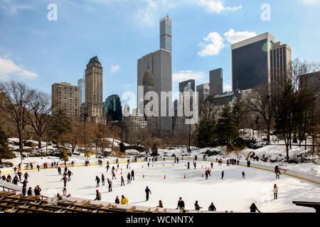 NEW YORK,NY, USA-FEBRUARY 18, 2015: Winter day scenery with New York city architecture skyline and ice rink in Central Park in New York City. - Stock Photo