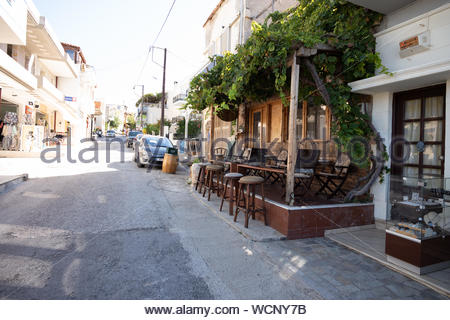 Took a little walk through the little beautiful village or town called Panormos on Crete Island, Greece with fine harbour, small shops, nice people - Stock Photo