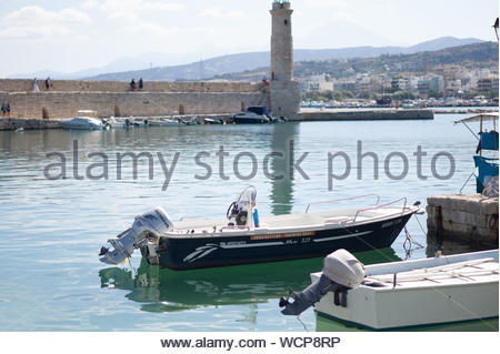 Visiting the old charming town of Rethymno. Crete island, Greece. A beautiful village at the mediterrane Sea with historic buildings and a nice harbor - Stock Photo