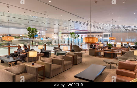The Cathay Pacific business lounge, Changi Airport, Singapore - Stock Photo
