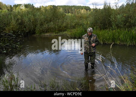 ALTAI TERRITORY, RUSSIA - AUGUST 28, 2019: Forest ranger Alexei Rovkovsky in a protected area of taiga managed by KBU Altaipriroda in Togul District of Russia's Altai Territory, which is to become part of a protected area under the working name of Togul National Park; according to the Russian government's project Ekologia (Ecology), the proposed national park is to be established by 2024 and to include parts of Zarinsk District, Togul District, and Yeltsovka District of the Altai Territory, with a total area of over 160 hectares. Kirill Kukhmar/TASS - Stock Photo