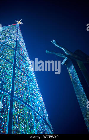 Enormous christmas tree in Vigo, Spain, near the Sireno emblematic statue - Stock Photo