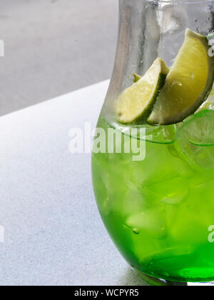Close-up Of Fresh Lemonade From Tarragon And Mint Leaves On Table - Stock Photo
