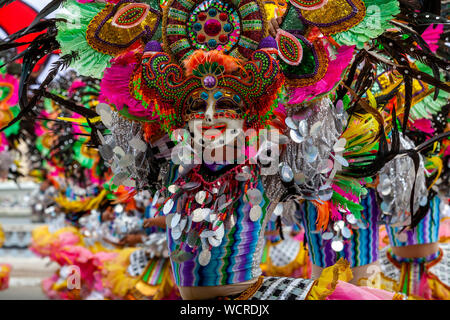 Local People In Colourful Costume Perform In The Kasadyahan Contest, Dinagyang Festival, Iloilo City, Panay Island, The Philippines. - Stock Photo