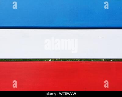 High Angle View Of French Flag Painted On Wooden Bench - Stock Photo