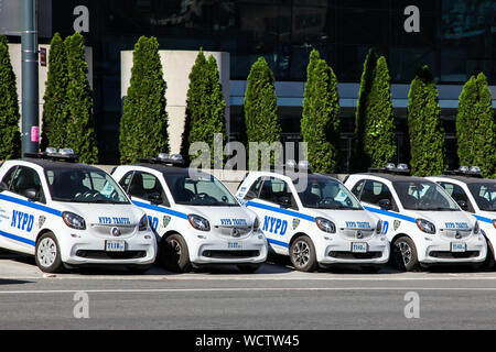 NEW YORK, NY, USA - OCTOBER 27, 2017:  NYPD traffic cars parking on street at Jacobs K. Javits Center. - Stock Photo