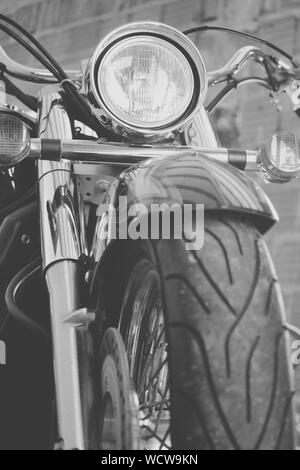 Close-up Of Motorcycle Parked Outdoors - Stock Photo