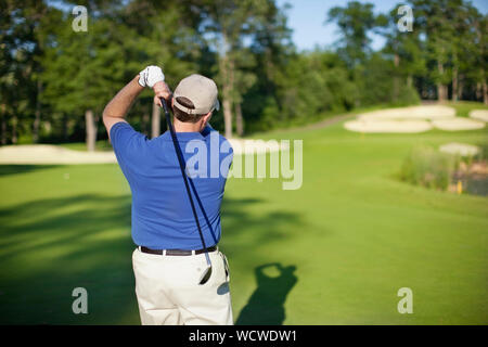 Rear View Of Man Playing Golf - Stock Photo