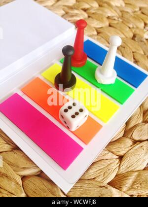 High Angle View Of Multi Colored Ludo On Table - Stock Photo